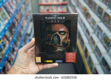 Bratislava, Slovakia, circa april 2017: Man holding Warhammer 40,000: Dawn of War III Limited Edition videogame on PC in store