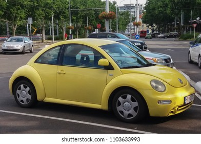 BRATISLAVA, SLOVAKIA - CIRCA JUNE 2016: yellow Volkswagen Beetle parked in a car park in the city centre
