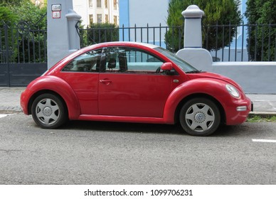 BRATISLAVA, SLOVAKIA - CIRCA MAY 2018: red Volkswagen new Beetle car parked in a street of the city centre
