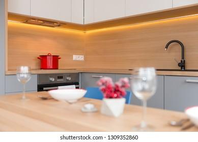 BRATISLAVA, SLOVAKIA - DEC 17, 2018: Kitchen area of small apartment designed by young interior designers from Kivvi architects based in Bratislava, Slovakia
