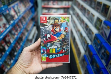 Bratislava, Slovakia, december 2, 2017: Man holding Super Mario Odyssey videogame on Nintendo Switch console in store