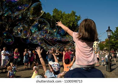 Bratislava, Slovakia, Europe / 17 may 2018 : street artist makes bubbles and kids have great joy in the city center at noon