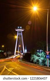 Bratislava, Slovakia, Europe / 21.october 2018 : SNP bridge is architecture former communist regime in center city in night.