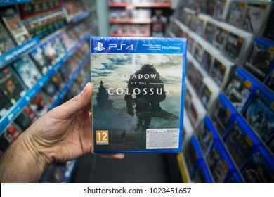 Bratislava, Slovakia, february 12, 2018: Man holding Shadow of the Colossus videogame on Sony Playstation 4 console in store