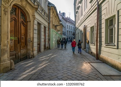 BRATISLAVA, SLOVAKIA - FEBRUARY 16, 2019: People in Old Town of Bratislava, Slovakia. Bratislava is the Capital of Slovakia and most visited city in Slovakia.,