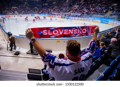 "BRATISLAVA, SLOVAKIA, FEBRUARY. 9. 2019: Slovak fans cheering for the team Slovakia victory. Hockey stadium in Bratislava. Title ""Slovensko"" at scarf"