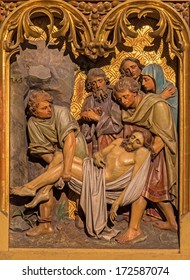 BRATISLAVA, SLOVAKIA - JANUARY 14, 2014: Burial of Jesus scene. Carved relief from 19. cent. by Ferdinand Prinoth from St. Ulrich  on gothic side altar in st. Martin cathedral.