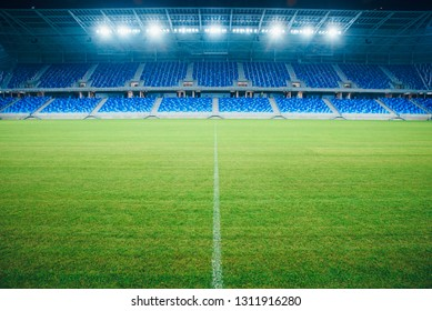 BRATISLAVA, SLOVAKIA, JANUARY. 16. 2019: Brand new National football stadium in Bratislava, Slovakia. Blue seats, football arena, spotlight