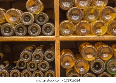BRATISLAVA, SLOVAKIA - JANUARY 23, 2014: Detail of bottles from Interior of wine callar of great Slovak producer.