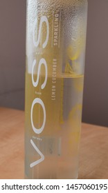 Bratislava, Slovakia - Jul 21, 2019: Voss cooled norway water bottle with a flavor of the lemon and cucumber on the table