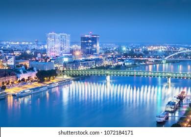Bratislava, Slovakia - July 26 2016: blue cityscape of Bratislava with Danube river