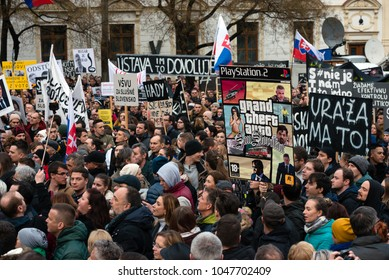 BRATISLAVA, SLOVAKIA - MAR 16, 2018: Protesters hold signs during an anti-government demonstration demanding a change in government in Bratislava, Slovakia