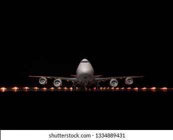 BRATISLAVA, SLOVAKIA - MARCH 10 2019: UPS Airlines Boeing 747-8F on night airport. Scale model of Boeing 747 on illuminated airport. Night airport and plane. Scale model plane 1:200.