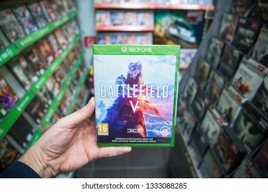 Bratislava, Slovakia, march 8, 2019: Man holding Battlefield V videogame on Microsoft XBOX One console in store