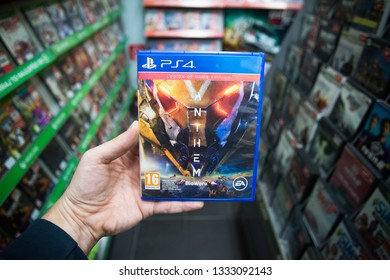 Bratislava, Slovakia, march 8 2019: Man holding Anthem videogame on Sony Playstation 4 console in store