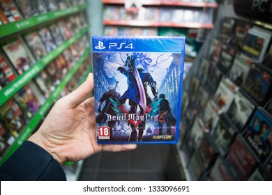 Bratislava, Slovakia, march 8 2019: Man holding Devil May Cry 5 videogame on Sony Playstation 4 console in store