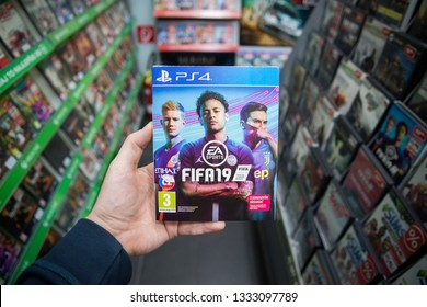 Bratislava, Slovakia, march 8 2019: Man holding Fifa 19 videogame on Sony Playstation 4 console in store