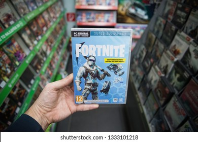 Bratislava, Slovakia, march 8, 2019: Man holding popular videogame Fortnite on PC in store