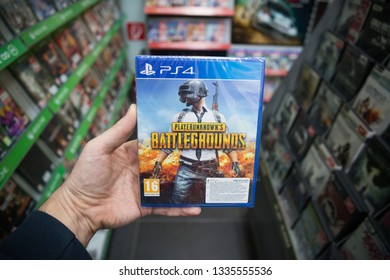 Bratislava, Slovakia, march 8 2019: Man holding Playerunknowns battlegroumds videogame on Sony Playstation 4 console in store