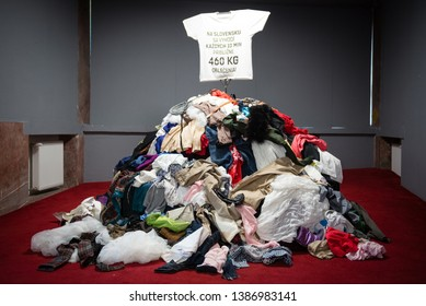 BRATISLAVA, SLOVAKIA - MAY 1, 2019: Installation of Pile of old worn clothes during Fashion revolution week. Approximately 460 kgs of clothes is thrown away every 10 minutes in Slovakia.