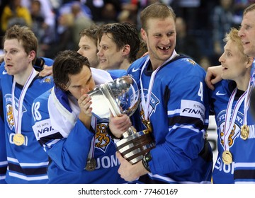 BRATISLAVA, SLOVAKIA - MAY 15: Finnish ice hockey players celebrate the victory in the gold medal game of World Cup. They beat the Swedish team 6-1 on May 15, 2011 in Bratislava, Slovakia.