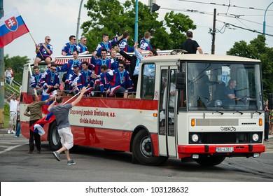 BRATISLAVA, SLOVAKIA - MAY 21: Bus full of Slovak ice hockey players celebrating the silver medal win in men's World Ice Hockey Championships goes through the city on 5/21/2012 in Bratislava, Slovakia