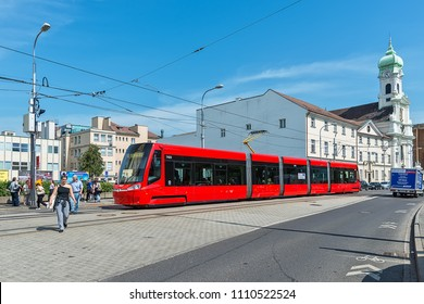 Bratislava, Slovakia - May 24, 2018: Tram drives down a busy central street in Bratislava.