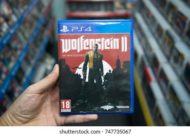 Bratislava, Slovakia, november 3, 2017: Man holding Wolfenstein 2: The New Colossus videogame on Sony Playstation 4 console in store