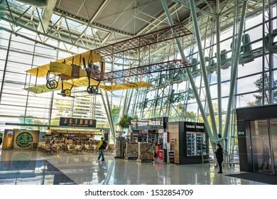 BRATISLAVA, SLOVAKIA – OCTOBER 6 2019: Inside of Departure hall of Bratislava airport terminal with historical plane of General M. R. Stefanik (Slovakia)
