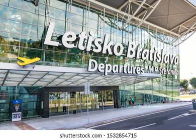 "BRATISLAVA, SLOVAKIA – OCTOBER 6 2019: entrance into Departure hall of Bratislava airport terminal with big letter sign ""M. R. Stefanik Airport Bratislava"" (Slovakia)"