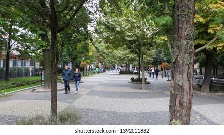 Bratislava / Slovakia - October 7, 2015: People walk along Hviezdoslavovo namestie. Hviezdoslav Square is located in the Old Town.