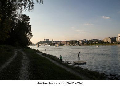 Bratislava, Slovakia - Panorama photo of the city from riverside of the Danube river with Bratislava Castle in distance.