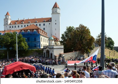 BRATISLAVA, SLOVAKIA - SEP1, 2019: The Slovak flag erected on the pole on September 1 during celebration of  Constitution Day in Bratislava, Slovakia