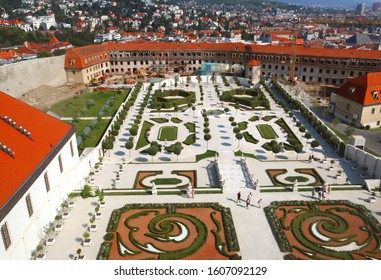 BRATISLAVA, SLOVAKIA - SEPTEMBER 01 2019: Unidentified tourists in Baroque Garden. Top view of garden and fortification building. Elevation point from Bratislava castle
