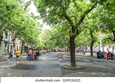 BRATISLAVA, SLOVAKIA - SEPTEMBER 17, 2016 : Popular street, starting with national theatre, surrounded by trees, cafes and restaurants. People are enjoying the street which is closed to traffic.