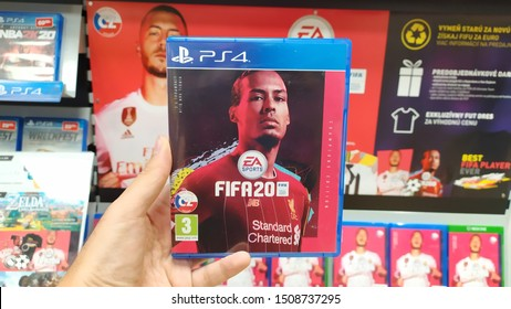 Bratislava, Slovakia, september 18 2019: Man holding Fifa 20 videogame on Sony Playstation 4 console in store
