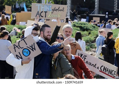 Bratislava, Slovakia - September, 20, 2019: Thousands of people attend the People's Climate March to stand up against climate change. Group of demonstrators fight for climate change.