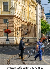 BRATISLAVA, SLOVAKIA - SEPTEMBER 25, 2013: Scene of the national theater square, with locals and visitors, In Bratislava, Slovakia