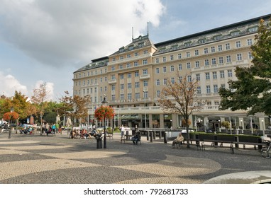 BRATISLAVA, SLOVAKIA - SEPTEMBER 25, 2017: People hava a rest and walk along Hviezdoslavovo namestie and Carlton hotel, located in the Old Town, between New Bridge and Slovak National Theatre.