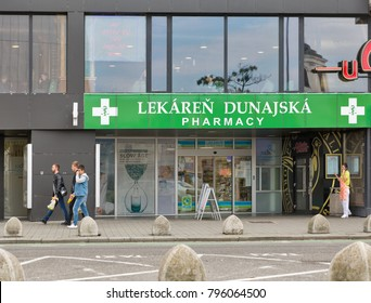 BRATISLAVA, SLOVAKIA - SEPTEMBER 26, 2017: People walk in front of Dunajska pharmacy in downtown. With a population of about 450 000, Bratislava is the capital and country's largest city.