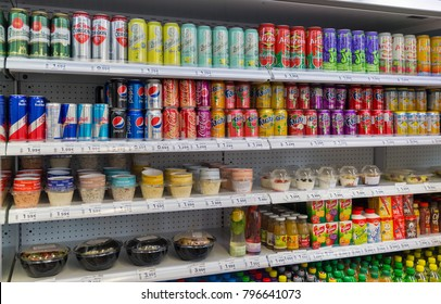 BRATISLAVA, SLOVAKIA - SEPTEMBER 26, 2017: Store shelves with colorful soft drinks, juice bottles, beer and snacks closeup.