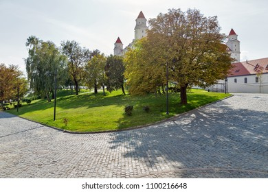 BRATISLAVA, SLOVALIA - SEPTEMBER 25, 2017: Medieval castle park on hill. Castle stands on an isolated rocky hill directly above the Danube river in the middle of Bratislava.