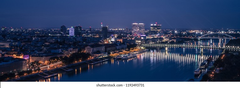 BRATISLAVA, SLOWAKIA - SEPTEMBER 20, 2018: Panorama of the capital Bratislava of Slowakia during the evening blue hour by night, with a view of the the bridge crossing the Danube river