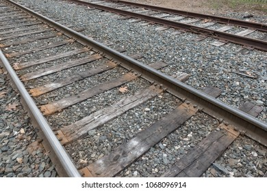 BRATTLEBORO, VT - APR. 2018: 2 Rail road tracks, wooden ties, note loose rail spike (in center of photo) on Amtrak line through Vermont.