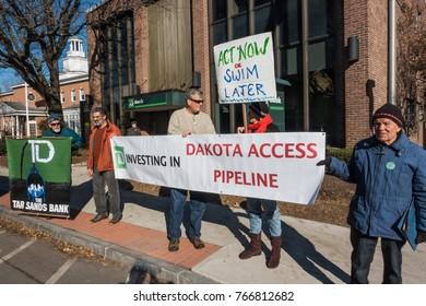 BRATTLEBORO, VT. - NOV. 25, 2017: Protestors outside TD bank demonstrating against TD Bank's indirect investing in Dakota Access Pipeline by lending money to Dakota Access LLC to build pipeline.