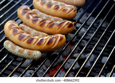 bratwurst on charcoal grill