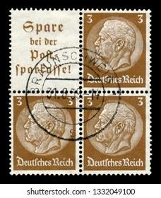 Braunschweig, Germany - 31 Aug 1938: German historical block of three stamps: Paul von Hindenburg-series medallions 1933-1936 issue, Braunschweig postmark 1938, Germany, the Third Reich.