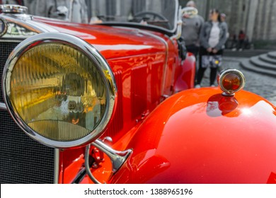 Braunschweig, Germany, April 7. 2019: headlights of a red classic sports car, the Fiat 514 MM as a roadster without hood.