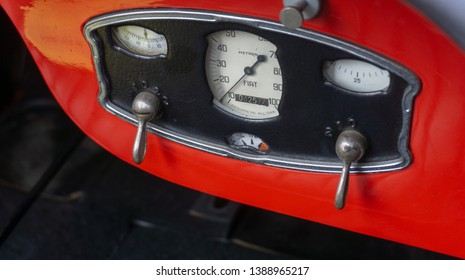 Braunschweig, Germany, April 7. 2019: Dashboard of a red classic sports car, the Fiat 514 MM as a roadster without hood, vintage