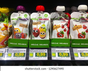 Braunschweig, Germany - December 13, 2018 : Freche Freunde, organic fruit and vegetable kids' food brand, kid snacks on the shelf for selling. kid food concept. pouch food for kid.